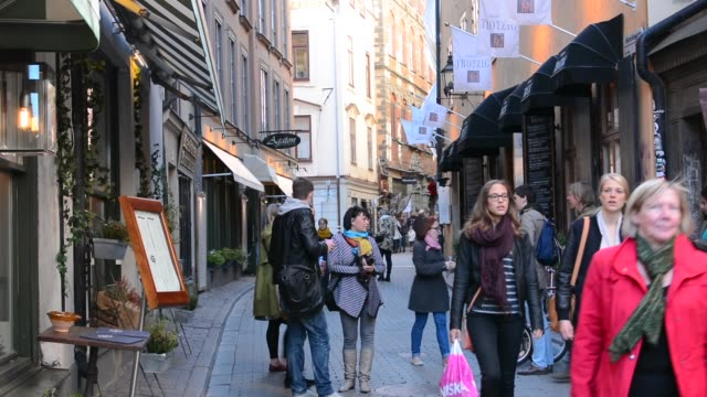 stockholm sweden downtown walking street in old town of gamla stan - tourist stock videos & royalty-free footage