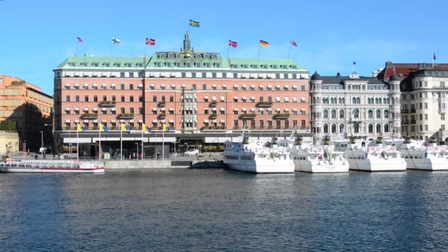 stockholm sweden exclusive grand hotel on water in downtown city - famous place stock videos & royalty-free footage