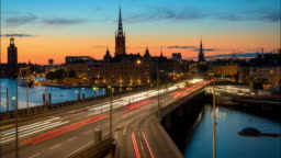 Stockholm, Sweden. Time lapse of Stockholm city center during sunset. Centralbron bridge with traffic