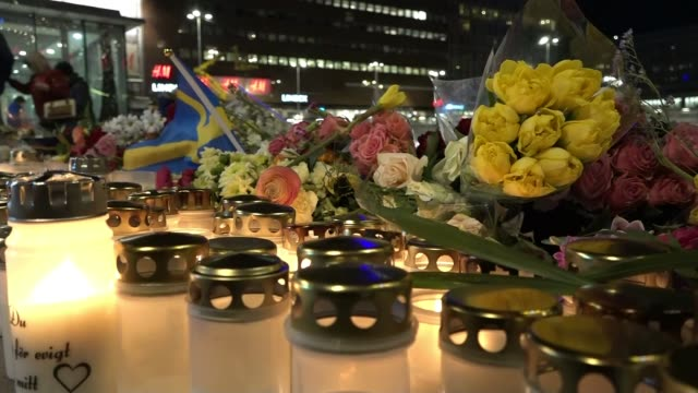 british victim named stockholm terror attack british victim named ext various of candles and flowers laid out by police van and near department store - terrorism bildbanksvideor och videomaterial från bakom kulisserna