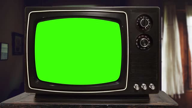 """stok video  vintage television set green background with noise and static. intro and outro, zoom in. you can replace green screen with the footage or picture you want with """"keying"""" effect in ae and any editing software - art and craft stock videos & royalty-free footage"""