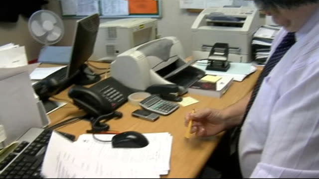 stoke city prepare for premiership england stokeontrent britannia stadium int secretary of stoke city fc receives fax of premiership fixture list - fax machine stock videos & royalty-free footage