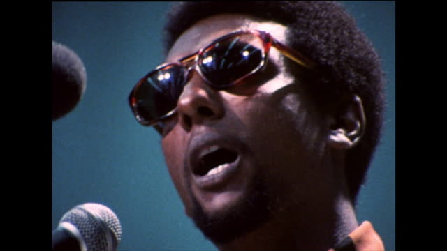 """stokely carmichael defines the meaning of 'black power': """"land is power. power is land. land is power. power is land. black power is the black man in... - アメリカ黒人の歴史点の映像素材/bロール"""