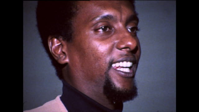 """stokely carmichael gives a speech and talks about continuing to fight for racial equality; """"we can never stop fighting until all our people our free... - アメリカ黒人の歴史点の映像素材/bロール"""
