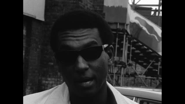 stokely carmichael leader of the black power movement speaking in response to the 1967 newark riots and believes that britain shouldn't be surprised... - measuring stock videos & royalty-free footage