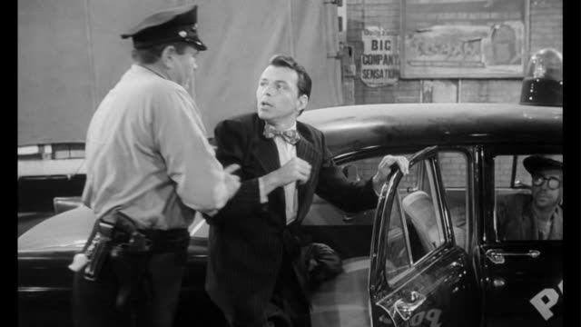 1955 a stolen suit gets man (frank sinatra) arrested - festnahme stock-videos und b-roll-filmmaterial