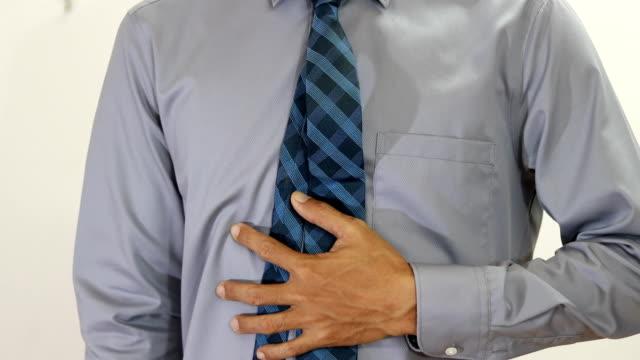 男性による腹痛 - 部分点の映像素材/bロール