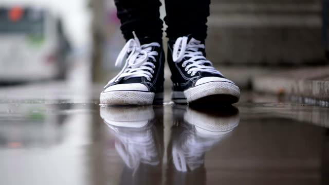 stomping in the puddle - shoe stock videos & royalty-free footage