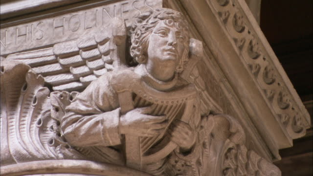 stone angel statue inside cathedral of st anne, belfast, northern ireland - protestantism stock videos & royalty-free footage