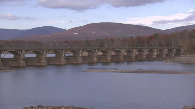a stone aqueduct spans a river in the new york countryside. - aqueduct stock videos and b-roll footage