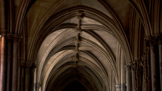 stone arches span a hallway in the ely cathedral. available in hd. - architectural feature stock videos & royalty-free footage