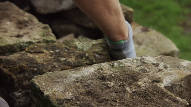 stone being placed into wall - stone wall stock videos and b-roll footage