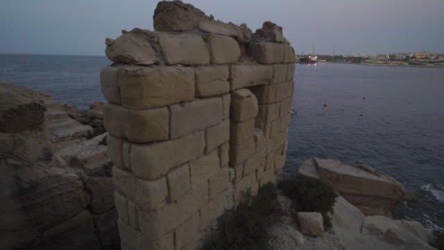 stone brick ruins on shore of valletta, malta - unesco world heritage site - valletta stock videos & royalty-free footage