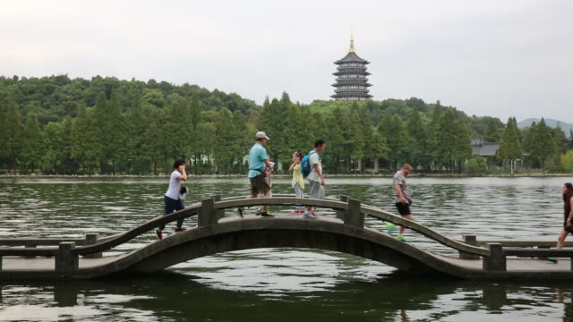 A stone bridge against Leifeng Pagoda on the West Lake,Hangzhou