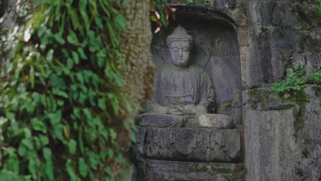 stone buddha statue in grotto at lingyin temple,hangzhou,china. - shrine stock videos & royalty-free footage