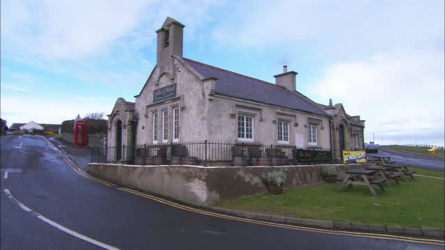 stone building, pub or schoolhouse onhill, northern ireland - schoolhouse stock videos & royalty-free footage