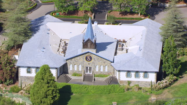 WS ZO AERIAL POV Stone building with steeple at Church of Scientology's Gold Base compound / Gilman Hot Springs, California, United States