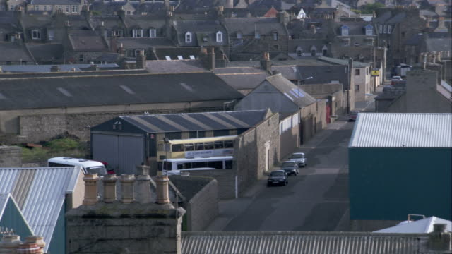 stone buildings and industrial buildings in crovie, scotland. available in hd. - クロヴィー点の映像素材/bロール