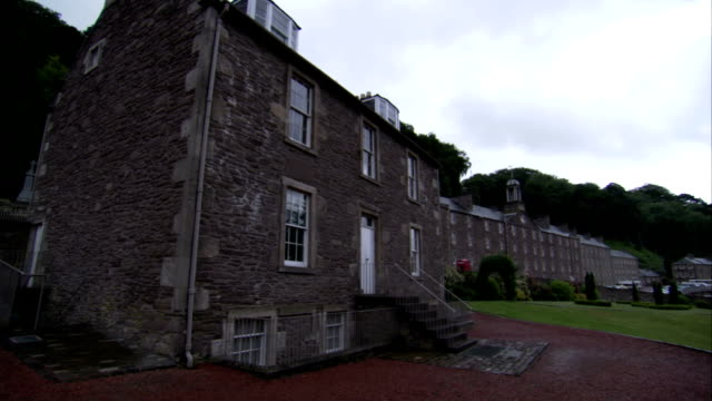 stone buildings form an apartment complex in scotland. available in hd. - dacherker stock-videos und b-roll-filmmaterial