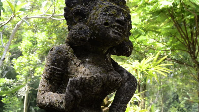 ms stone carved god like figure in tropical garden / ubud, bali, indonesia - female likeness stock videos & royalty-free footage