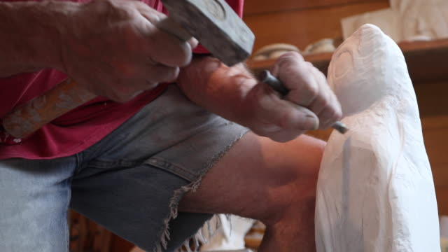 stone carver working on a piece - mallet hand tool stock videos and b-roll footage