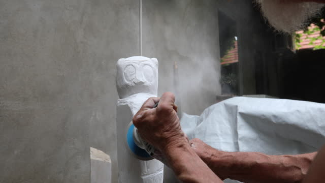 Stone carver working with tool