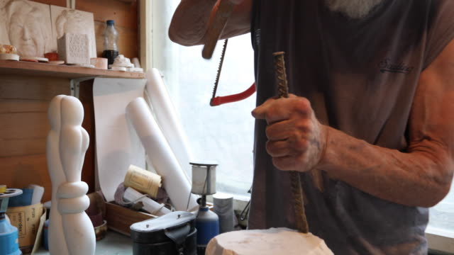stone carver's hands - mallet hand tool stock videos and b-roll footage