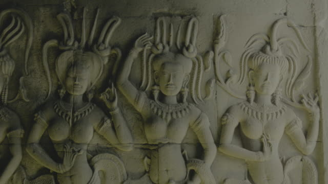 Stone carving on the wall in Angkor Wat