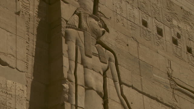 Stone carvings depict Egyptian deities on the exterior of the Temple of Isis on Agilkia Island.