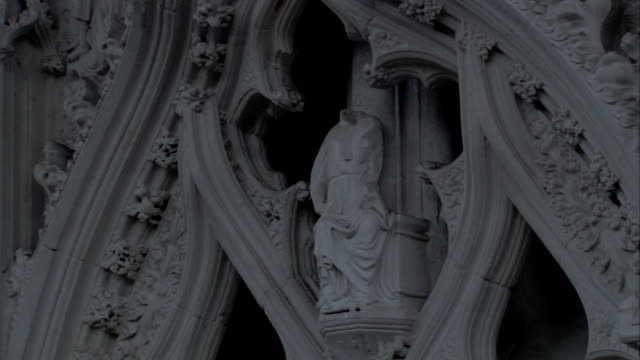 stone carvings surround a headless statue in st edmundsbury cathedral, bury st edmunds. available in hd. - bury st edmunds stock videos & royalty-free footage
