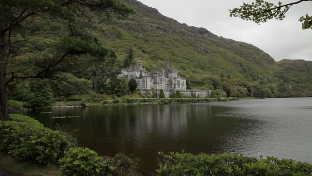 ws pan stone castle next to lake / ireland - castle stock videos & royalty-free footage