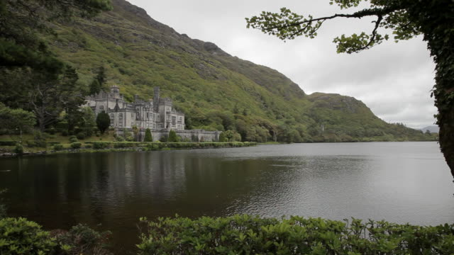 ws ld stone castle next to lake / ireland - establishing shot stock videos & royalty-free footage