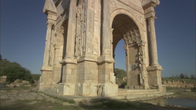 MS TU Stone ceremonial archway in roman ruins of Leptis Magna / Al Khums, Al Khums District, Libya