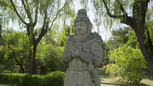 stone chinese warrior statue on the sacred way of ming dynasty tombs - beijing, china - ming tombs stock videos and b-roll footage