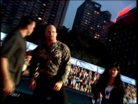 Stone Cold Steve Austin is walking the 1999 MTV Video Music Awards red carpet