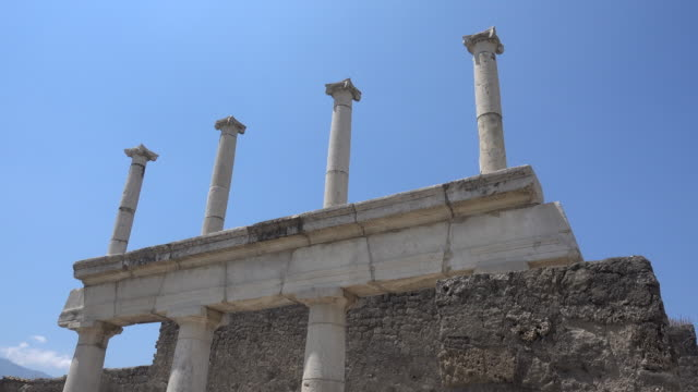 Stone columns in the ancient ruins sightseeing historic landmark of Pompeii, Italy, Europe.