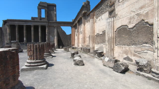 Stone columns in the ancient ruins sightseeing historic landmark of Pompeii, Italy, Europe. - Slow Motion