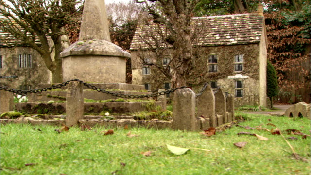 stone cottages and war memorial in cotswolds village. available in hd. - cotswolds stock videos & royalty-free footage