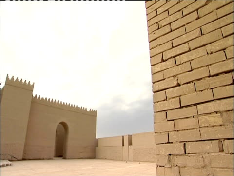 a stone courtyard lies within the walls of an ancient building. - babylon stock videos and b-roll footage