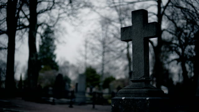 stone cross tombstone cemetery - cemetery stock videos & royalty-free footage