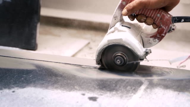 stone cutter machine with water jet cutting granite stone to make kitchen countertop. - marble stock videos & royalty-free footage