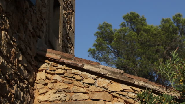 stone facade detail of a house with trees and sky - stone house stock videos & royalty-free footage