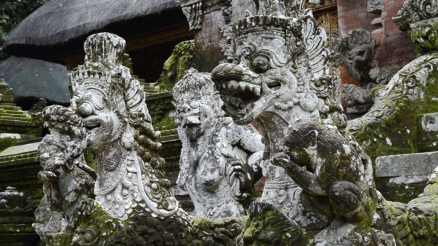 cu stone figures and macaque monkeys in pura dalem agung temple in monkey forest / ubud, bali, indonesia - indonesia travel stock videos & royalty-free footage