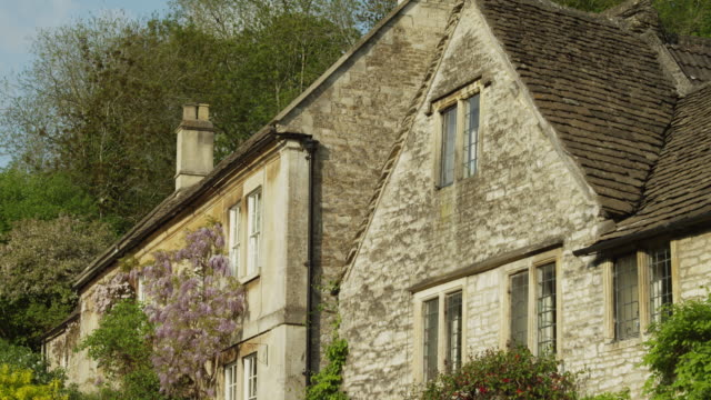 ms tu stone house exterior / castle combe, cotswolds, wiltshire, uk - stone house stock videos & royalty-free footage