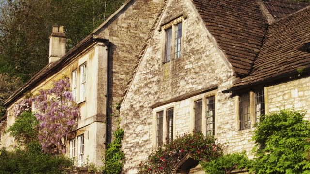 ms pan stone house exterior / castle combe, cotswolds, wiltshire, uk - stone house stock videos & royalty-free footage