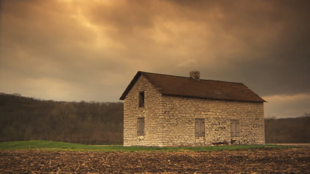 ws stone house in rural landscape, iowa, usa - stone house stock videos & royalty-free footage