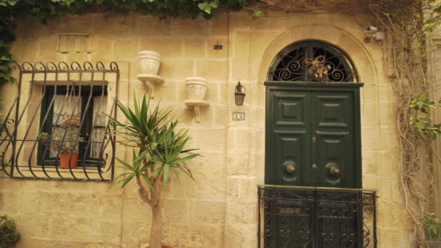stone house with vines - malta - europe stock videos & royalty-free footage