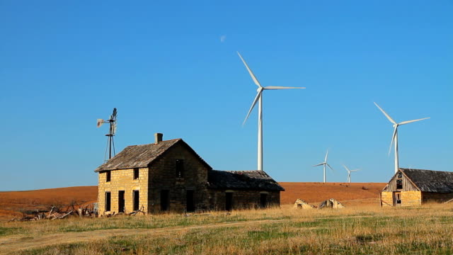 stone house with wind turbines - stone house stock videos & royalty-free footage