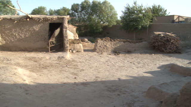 Stone huts in an Afghan village appear empty.