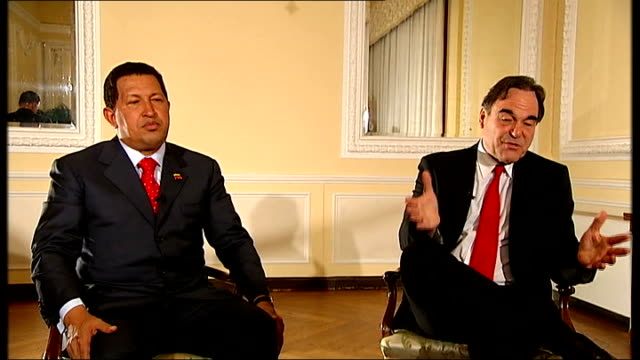 stone interview with chavez beside sot outrageous double standard / most vicious antichavez press i've ever seen 8090 percent of them attacking him... - staatsstreich stock-videos und b-roll-filmmaterial